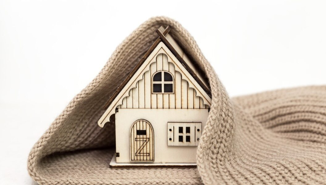 toy-wooden-house-wrapped-in-a-warm-knitted-scarf-on-a-white-background-business-concept-buy_t20_pxAoBj-2